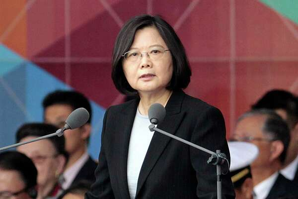 "FILE - In this Oct. 10, 2016, file photo, Taiwan's President Tsai Ing-wen delivers a speech during National Day celebrations in front of the Presidential Building in Taipei, Taiwan. President-elect Donald Trump spoke Dec. 2, with the president of Taiwan, a self-governing island the U.S. broke diplomatic ties with in 1979. It is highly unusual, perhaps unprecedented, for a U.S. president or president-elect to speak directly with a Taiwanese leader and will be sure to anger China. Washington has pursued a so-called ""one China"" policy since 1979 when it shifted diplomatic recognition of China from the government in Taiwan to the communist government on the mainland. (AP Photo/Chiang Ying-ying, File) ORG XMIT: WX107"