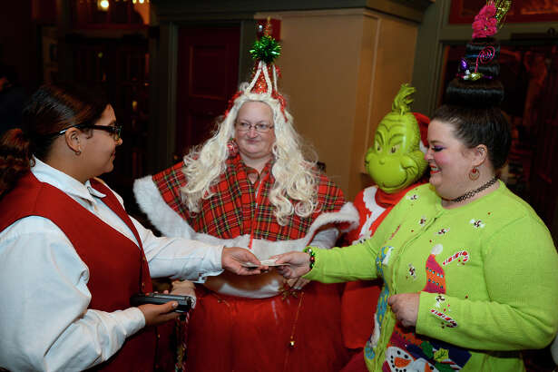 """Lisa Reynolds, Eden Manning and Laurie Manning come dressed in costume for the showing of """"Dr. Seuss' How the Grinch Stole Christmas"""" starring Jim Carrey at the Jefferson Theatre on Friday night. The theater will show """"Elf"""" on Dec. 9 and """"A Christmas Story"""" on Dec. 16.  Photo taken Friday 12/2/16 Ryan Pelham/The Enterprise"""