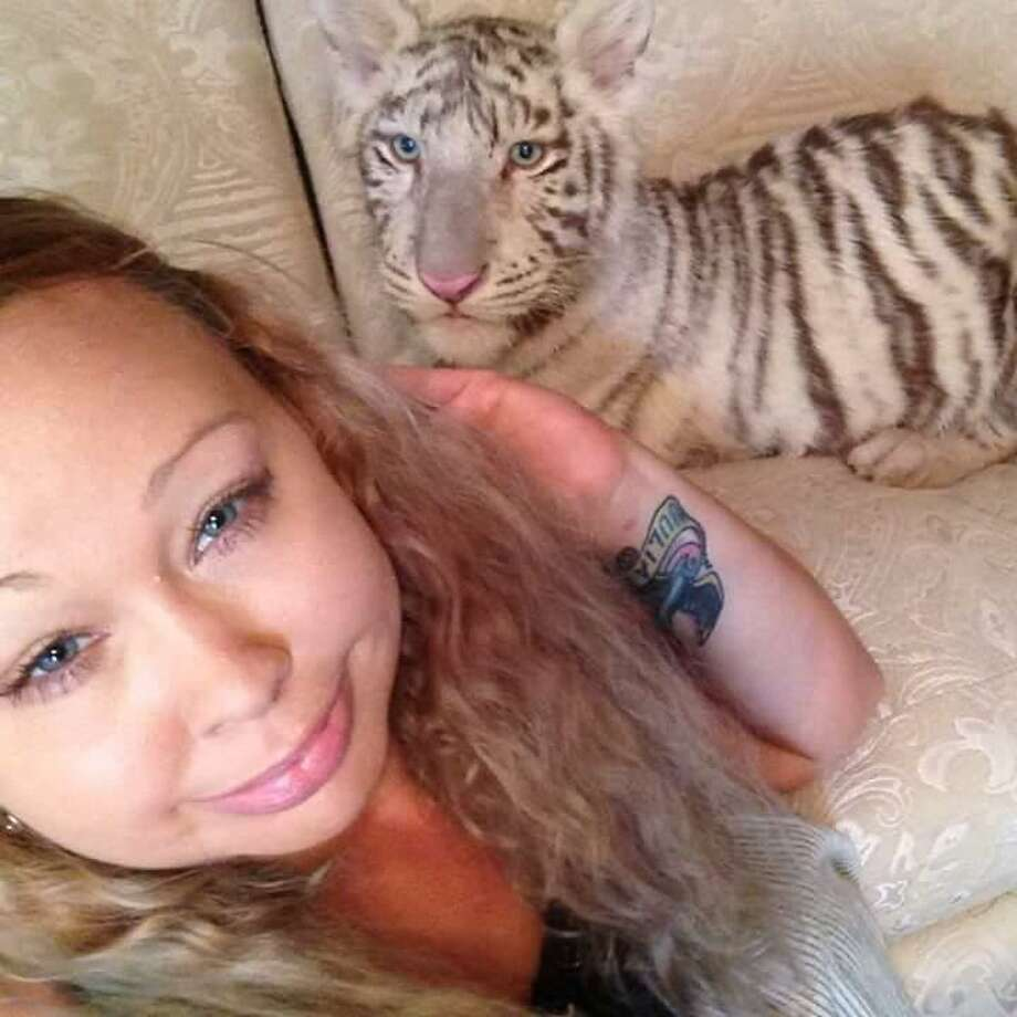 Trisha Meyer poses for a selfie with a white tiger. Meyer has been accused with child endangerment for allegedly letting her animals run free in the house with her daughter.  Photo: Photo Provided By Trisha Myers