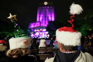 Rebecca Smith and Gary Smith wear Christmas hats they got from Nutcrackers Market a few years ago to the 97th Annual Mayor's Holiday Celebration and Tree Lighting Presented by Reliant at City Hall Friday, Dec. 2, 2016, in Houston.