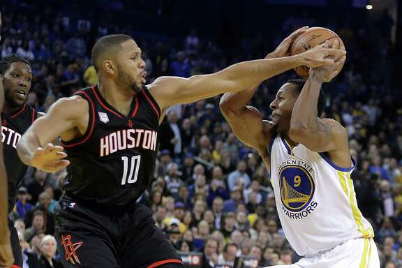 Eric Gordon, left, plays some sticky defense against the Warriors' Andre Iguodala during the Rockets' double-overtime victory Thursday night.