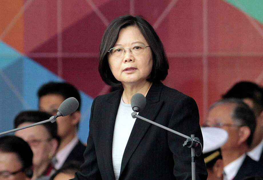"""FILE - In this Oct. 10, 2016, file photo, Taiwan's President Tsai Ing-wen delivers a speech during National Day celebrations in front of the Presidential Building in Taipei, Taiwan. President-elect Donald Trump spoke Dec. 2, with the president of Taiwan, a self-governing island the U.S. broke diplomatic ties with in 1979. It is highly unusual, perhaps unprecedented, for a U.S. president or president-elect to speak directly with a Taiwanese leader and will be sure to anger China. Washington has pursued a so-called """"one China"""" policy since 1979 when it shifted diplomatic recognition of China from the government in Taiwan to the communist government on the mainland. (AP Photo/Chiang Ying-ying, File) Photo: Chiang Ying-ying, STR / Copyright 2016 The Associated Press. All rights reserved."""