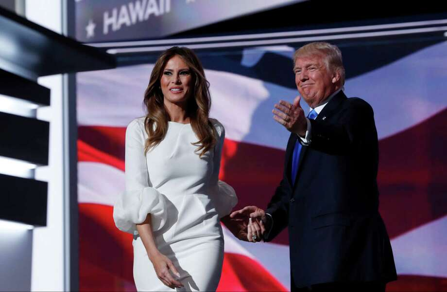 """FILE - In this July 18, 2016, file photo, Melania Trump, wife of Republican Presidential Candidate Donald Trump walks to the stage as Donald Trump introduces her during the opening day of the Republican National Convention in Cleveland. Fashion designer Tom Ford said on ABC's """"The View"""" Wednesday, Nov. 30, 2016, that he had had been asked to dress Mrs. Trump """"quite a few years ago"""" and declined because """"she's not necessarily my image."""" (AP Photo/Carolyn Kaster, File) Photo: Carolyn Kaster, STF / Copyright 2016 The Associated Press. All rights reserved. This material may not be published, broadcast, rewritten or redistribu"""