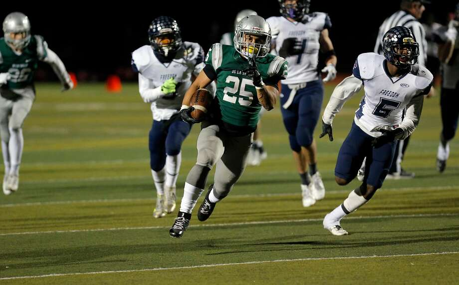 Spartans Kairee Robinson, 25 on a 31 yard touchdown run in the second quarter, as De La Salle-Concord  takes on Freedom in the North Ooast section open division football championship at  Dublin hIgh school in Dublin, California, on Friday December 2, 2016. Photo: Michael Macor, The Chronicle