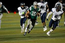 Spartans Kairee Robinson, 25 on a 31 yard touchdown run in the second quarter, as De La Salle-Concord  takes on Freedom in the North Ooast section open division football championship at  Dublin hIgh school in Dublin, California, on Friday December 2, 2016.