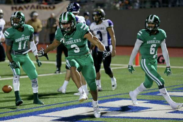Cuero's Jordan Whittington celebrates after scoring a touchdown against Navarro during first half action of their Class 4A Division II state quarterfinals  playoff game held Friday Dec. 2, 2016 at Alamo Stadium.