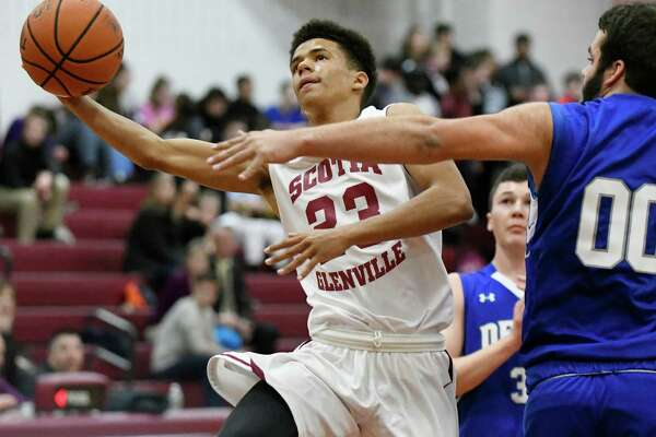 Scotia's Sean DeGraffenreid, center, goes to the hoop as Ogdensburg's Matt Rector defends during their basketball game on Friday, Dec. 2, 2016, at Scotia High in Scotia, N.Y. (Cindy Schultz / Times Union)