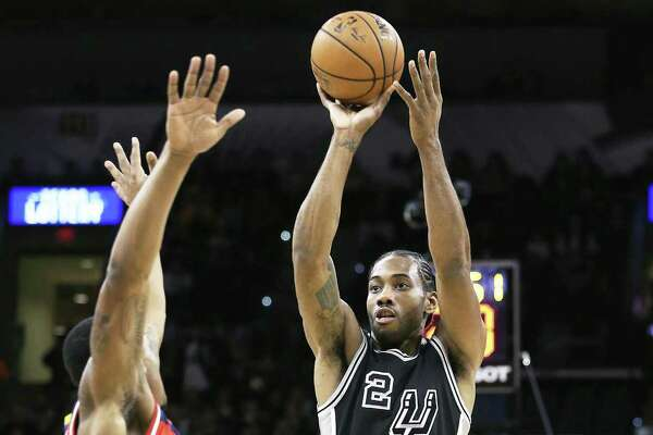 Kawhi Leonard takes a jumper in the first half during Friday's victory. Leonard finished with a team-high 23 points and drained the winning shot.