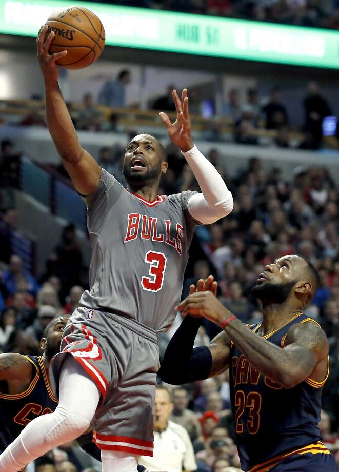 Bulls guard Dwyane Wade (left) drives past Cavaliers forward LeBron James. Photo: Nam Y. Huh, Associated Press