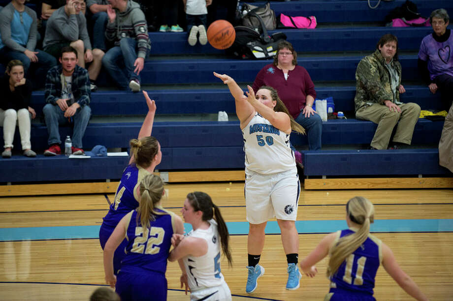BRITTNEY LOHMILLER | blohmiller@mdn.net Meridian's Alexis Jones shoots in the first half of Friday's game against Farwell.  More photos from the game are on page B2.