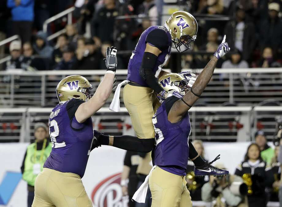 Washington tight end Darrell Daniels, right, celebrates his touchdown catch with teammates Aaron Fuller, center, and Jake Eldrenkamp during the first half of the Pac-12 Conference championship NCAA college football game against Colorado on Friday, Dec. 2, 2016, in Santa Clara, Calif. (AP Photo/Marcio Jose Sanchez) Photo: Marcio Jose Sanchez, Associated Press