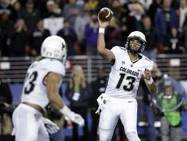 Colorado quarterback Sefo Liufau (13) throws to running back Phillip Lindsay during the first half of the Pac-12 Conference championship NCAA college football game against Colorado on Friday, Dec. 2, 2016, in Santa Clara, Calif. (AP Photo/Marcio Jose Sanchez)