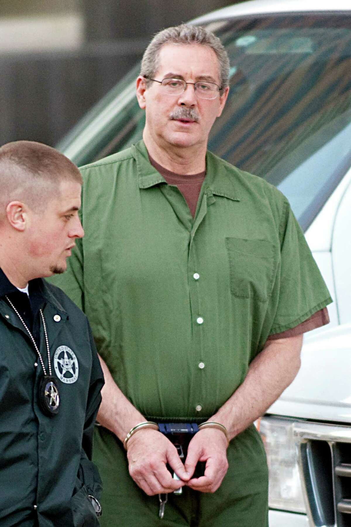 Indicted financier R. Allen Stanford, accused of leading a $7 billion investment fraud scheme, arrives for a hearing at the Bob Casey Federal Courthouse in Houston, Texas, U.S,. on Thursday, Jan. 6, 2011. Stanford's court-appointed defense lawyers told the court that their client may be psychologically unfit to stand trial and have asked for a hearing to assess his competency. Photographer: F. Carter Smith/Bloomberg *** Local Caption *** R. Allen Stanford