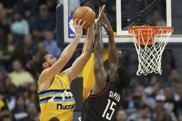 DENVER, CO - DECEMBER 02:  Danilo Gallinari #8 of the Denver Nuggets drives to the basket against Clint Capela #15 of the Houston Rockets at the Pepsi Center on December 2, 2016 in Denver, Colorado. NOTE TO USER: User expressly acknowledges and agrees that , by downloading and or using this photograph, User is consenting to the terms and conditions of the Getty Images License Agreement.