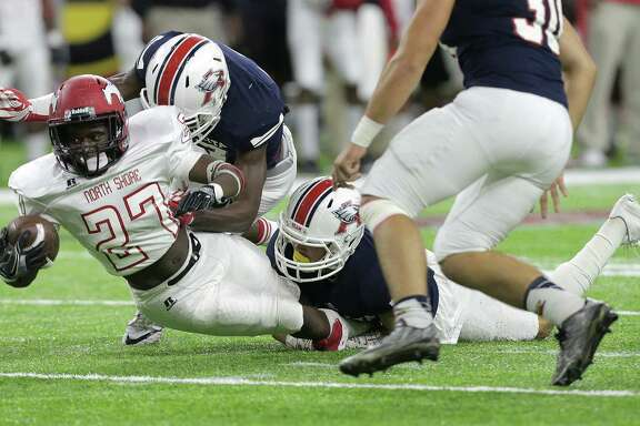 North Shore Darion Mcdaniel (27) leans in for a first down in the first half of Class 6A, Division I state quarterfinals against Atascocita (11-1) on Friday, Dec. 2, 2016, at NRG Stadium in Houston. ( Elizabeth Conley / Houston Chronicle )