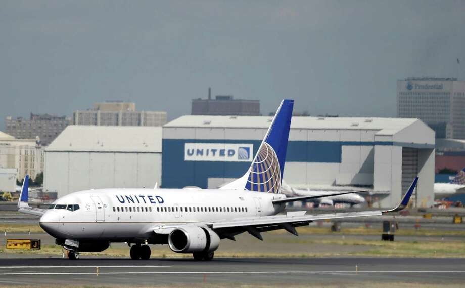 FILE - In this Sept. 8, 2015 file photo, a United Airlines passenger plane lands at Newark Liberty International Airport in Newark, N.J. A man and a woman were kicked off a United Airlines flight Saturday evening for causing a disturbance that was blamed on racist comments. Photo: Mel Evans, STF / ap