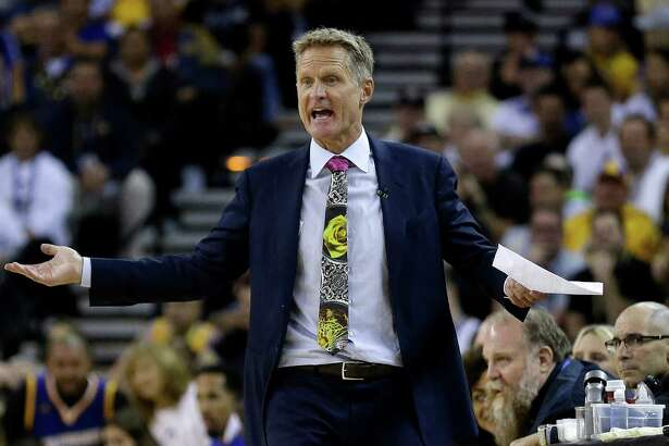 FILE - In this Oct. 25, 2016, file photo, Golden State Warriors coach Steve Kerr reacts during the team's NBA basketball game against the San Antonio Spurs in Oakland, Calif. Kerr, the reigning NBA Coach of the Year, acknowledged he tried marijuana twice in the past 18 months while dealing with debilitating back pain. Kerr told Comcast SportsNet Bay Area's Warriors Insider Podcast with Monte Poole on Friday, Dec. 2, that he used medicinal marijuana but it didn't help.