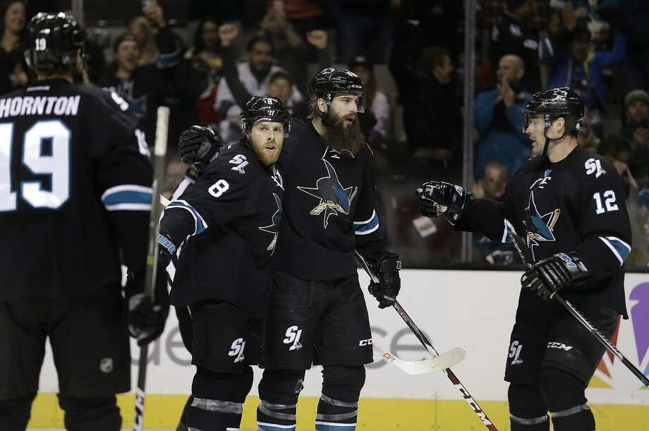 Sharks defenseman Brent Burns celebrates his first-period goal with Joe Pavelski (8) and Patrick Marleau (12). Photo: Ben Margot, Associated Press