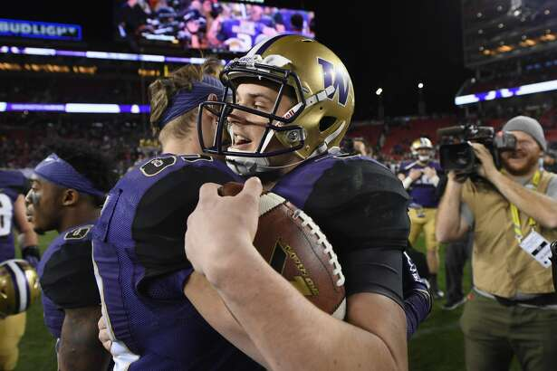 Jake Browning of the Washington Huskies is congratulated by teammates after they beat the Colorado Buffaloes in the Pac-12 Championship game at Levi's Stadium on December 2, 2016 in Santa Clara, California.  (Photo by Robert Reiners/Getty Images)