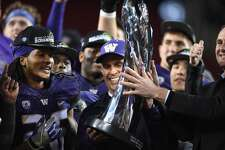 Head coach Chris Petersen of the Washington Huskies is awarded the Pac-12 Championship game trophy after they beat the Colorado Buffaloes at Levi's Stadium on December 2, 2016 in Santa Clara, California.  (Photo by Thearon W. Henderson/Getty Images)