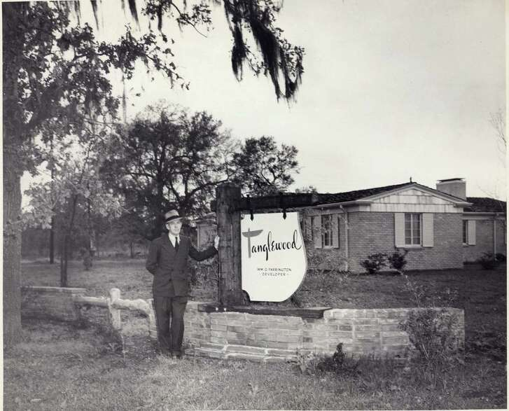 Real estate developer William Farrington, who created Tanglewood, stands at the entrance to the neighborhood in 1949.