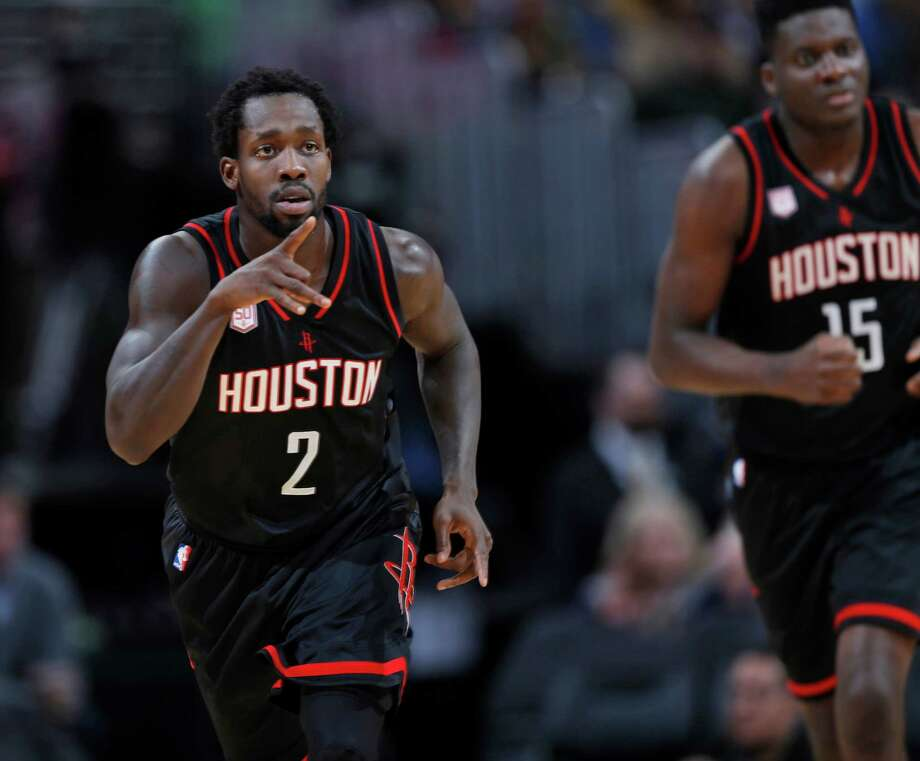 Houston Rockets guard Patrick Beverley gestures to the bench after hitting a 3-point basket against the Denver Nuggets duringp the second half of an NBA basketball game late Friday, Dec. 2, 2016, in Denver. The Rockets won 128-110. (AP Photo/David Zalubowski) Photo: David Zalubowski, Associated Press / Copyright 2016 The Associated Press. All rights reserved.