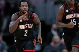 Houston Rockets guard Patrick Beverley gestures to the bench after hitting a 3-point basket against the Denver Nuggets duringp the second half of an NBA basketball game late Friday, Dec. 2, 2016, in Denver. The Rockets won 128-110. (AP Photo/David Zalubowski)