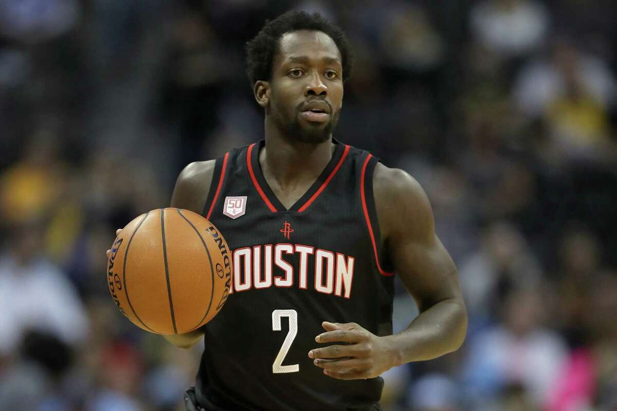 DENVER, CO - DECEMBER 02: Patrick Beverley #2 of the Houston Rockets brings the ball down court against the Denver Nuggets at the Pepsi Center on December 2, 2016 in Denver, Colorado. NOTE TO USER: User expressly acknowledges and agrees that , by downloading and or using this photograph, User is consenting to the terms and conditions of the Getty Images License Agreement.