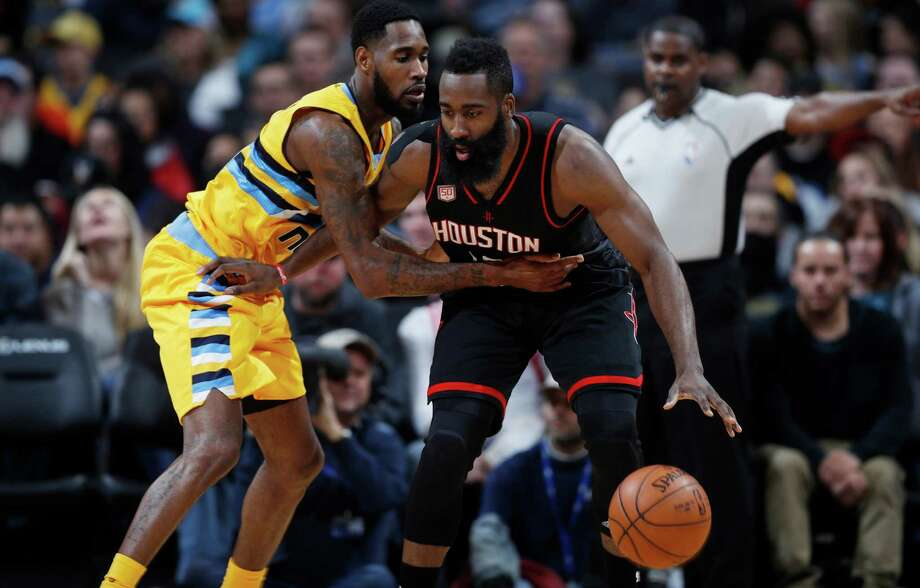 Houston Rockets guard James Harden, right, loses control of the ball as Denver Nuggets guard Will Barton defends during the second half of an NBA basketball game Friday, Dec. 2, 2016, in Denver. The Rockets won 128-110. (AP Photo/David Zalubowski) Photo: David Zalubowski, Associated Press / Copyright 2016 The Associated Press. All rights reserved.