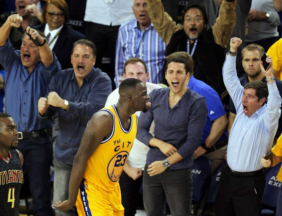 Draymond Green (23) reacts after shooting the game-winning three-point shot in the overtime period as the Golden State Warriors played the Atlanta Hawks at Oracle Arena in Oakland, Calif., on Tuesday, March 1, 2016. Golden State won 109-105, to maintain their perfect home record.