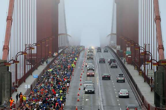 Runners and motorists make their way across the Golden Gate Bridge during the San Francisco Marathon in San Francisco, Calif., on Sunday, July 31, 2016.