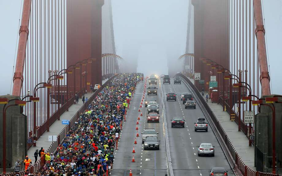 Runners and motorists make their way across the Golden Gate Bridge during the San Francisco Marathon in San Francisco, Calif., on Sunday, July 31, 2016. Photo: Carlos Avila Gonzalez, The Chronicle