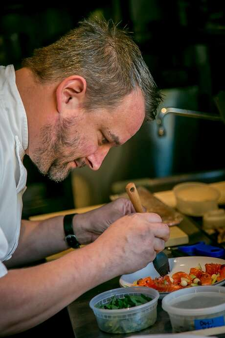 Chef Gavin Schmidt plates a dish at the Morris. Photo: John Storey, Special To The Chronicle