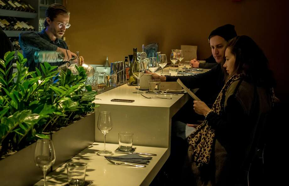 People have dinner at the bar at the Morris. Photo: John Storey, Special To The Chronicle