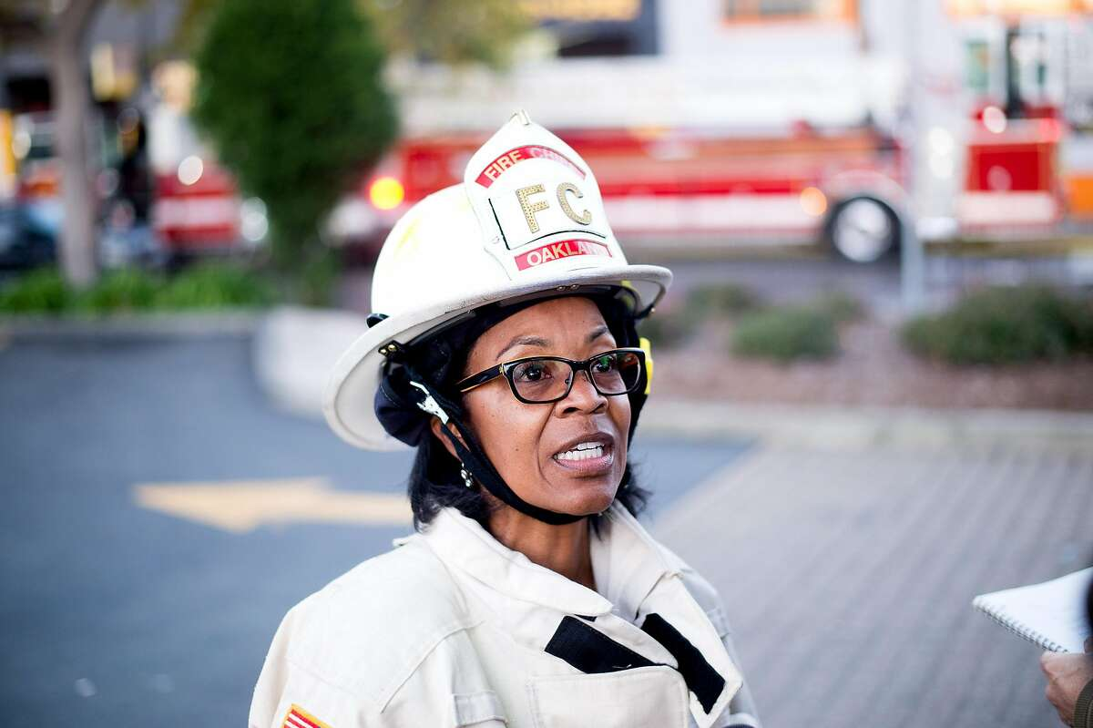 Oakland Fire Chief Fire Teresa Deloach Reed speaks with reporters at the scene of a fire that killed at least nine people on 31st Avenue in Oakland, Calif., on Saturday, Dec. 3, 2016.