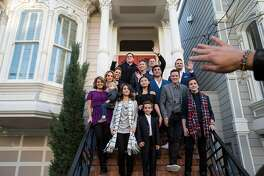 "The cast of the Netflix show ""Fuller House"" along with ""Full House"" creator Jeff Franklin pose for photos outside the property used in the sitcoms as the home of the fictional Tanner family during a press event for the second season of ""Fuller House"" in San Francisco, Calif., on Friday, December 2, 2016. Franklin recently purchased the property."