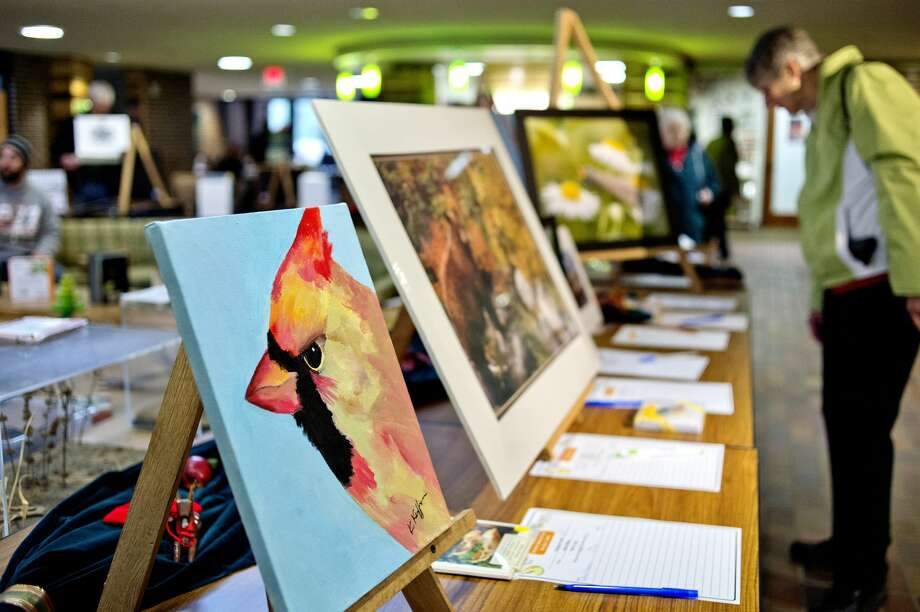 An acrylic painting of a Cardinal by artist Ken Kueffner is on display with other works as part of a silent auction during the Chippewa Nature Center's annual Nature Art Show and Sale on Saturday. Artists were on hand selling their works including pottery, jewelry, fiber art, baskets and more. Photo: NICK KING | Nking@mdn.net