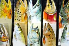 Color pencil and paint fish bookmarks are on display at the Ken Kueffner Studio booth during the Chippewa Nature Center's annual Nature Art Show and Sale on Saturday. Artists were on hand selling their works including pottery, jewelry, fiber art, baskets and more. The event also featured a silent auction.