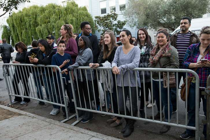 """Fans line up along Broderick Street to see the cast of the original """"Full House"""" and the Netflix sequel """"Fuller House"""" during a press event outside the property used in the sitcom as the home of the fictional Tanner family."""