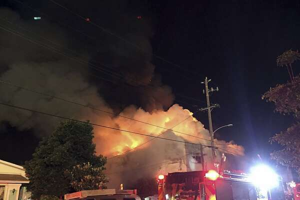 This photo provided by @seungylee14  shows the scene of a fire in Oakland, early Saturday, Dec. 3, 2016.   The blaze began at about 11:30 p.m. on Friday during a party at a warehouse in the San Francisco Bay Area city.  Several people were unaccounted for.  (@seungylee14 via AP)
