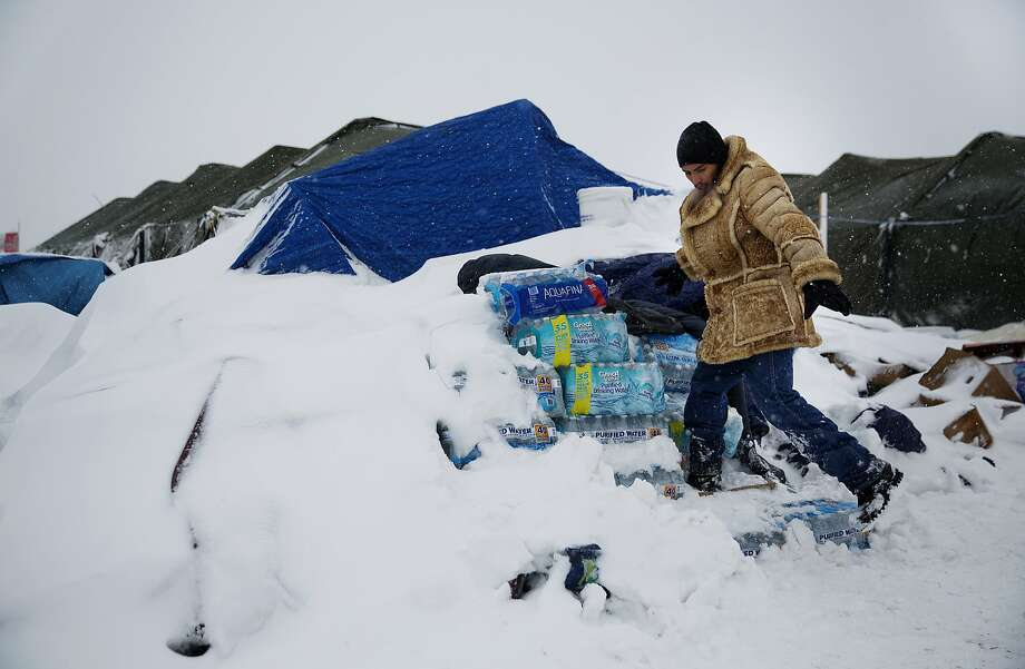 Lawrence Valdez, a member of the Chiricahua Apache tribe in New Mexico, drops off supplies at a protest camp near Cannon Ball, N.D., and the Dakota Access oil pipeline project. Photo: David Goldman, Associated Press