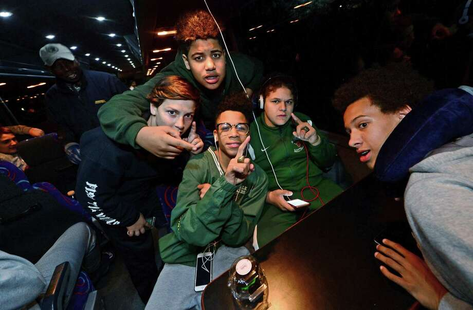 Norwalk Packers 13U football team members, Jake Lusardo, Andrez Sanchez, Najee Hamlette, Isaiah Valentine and Christian Shaffer celebrate aboard their bus before setting off from Brien McMahon High School in Norwalk, Conn. Friday, December 2, 2016, on their way to Orlando to compete in the American Youth Football National Championship. Photo: Erik Trautmann / Hearst Connecticut Media / Norwalk Hour