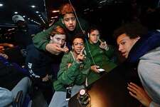 Norwalk Packers 13U football team members, Jake Lusardo, Andrez Sanchez, Najee Hamlette, Isaiah Valentine and Christian Shaffer celebrate aboard their bus before setting off from Brien McMahon High School in Norwalk, Conn. Friday, December 2, 2016, on their way to Orlando to compete in the American Youth Football National Championship.