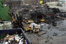 "WEST WARWICK, RHODE ISLAND - FEBRUARY 23:  The burned remnants of ""The Station"" nightclub litters the scene February 23, 2003 in West Warwick, Rhode Island. A deadly fire, that took the lives of 96 people, started when a pyrotechnics display during a concert set the club's sound proofing aflame February 20, 2003.  (Photo By Douglas McFadd/Getty Images)"