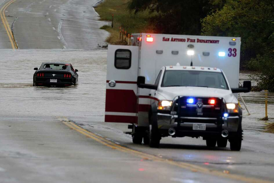 Rescue crews helped a driver and a passenger out of a Ford Mustang that became stuck in high water from a creek along West Commerce and Pinn Road on Saturday, Dec. 3, 2016. Weather forecasts have called for continued rain storms in the area through the weekend. The two individuals were safely extracted from the vehicle and were treated at the location.