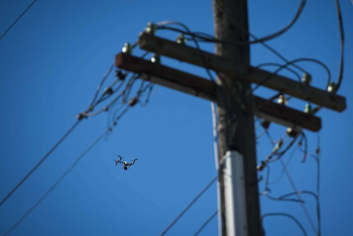 A drone, apparently operated by law enforcement, is seen above the scene of a fire near 31st Avenue and International Boulevard in Oakland in December.