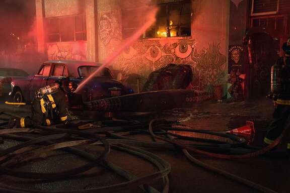 Firefighters work at the scene of a fatal fire on 31st Ave. in Oakland, Calif., on Saturday, Dec. 3, 2016.Firefighters work at the scene of a fatal fire on 31st Ave. in Oakland, Calif., on Saturday, Dec. 3, 2016.