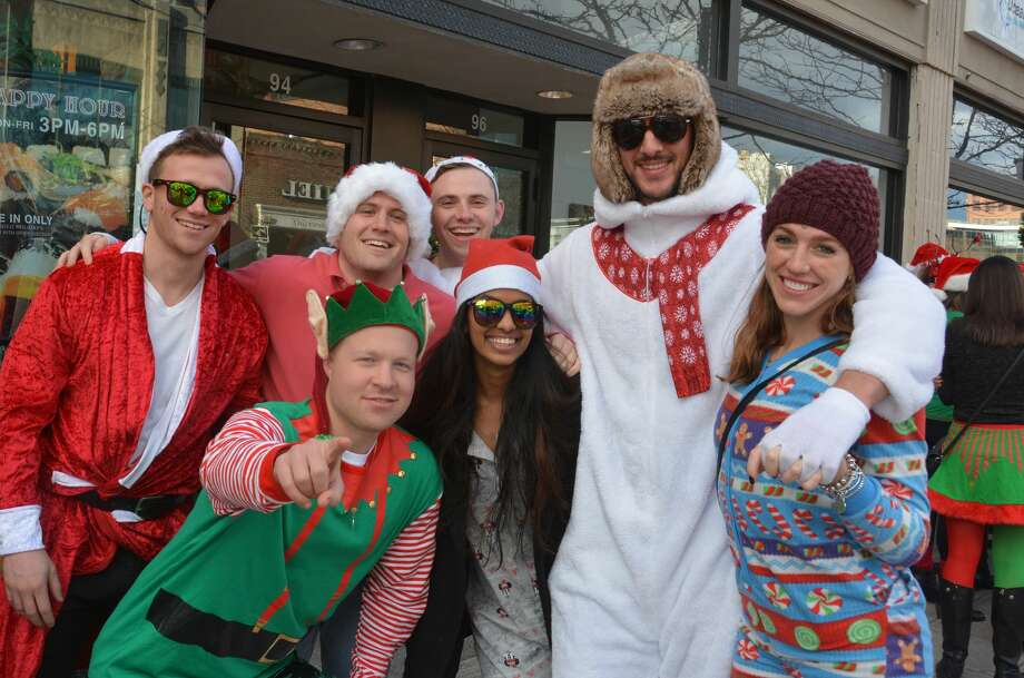 Droves of Santas descended on the streets of Stamford for the annual SantaCon pub crawl on December 3, 2016. Revelers dressed in holiday garb took advantage of drink specials at participating Bedford Avenue bars. Were you SEEN? Photo: Vic Eng / Hearst Connecticut Media Group