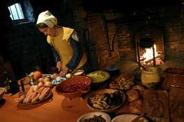 Dawn Elliott dressed in colonial garb prepares the Netherlands dish,hutspot, a root vegetable mash during a Dutch holiday celebration at Crailo State Historic Site on Saturday Dec. 3, 2016 in Rensselaer, N.Y.  (Michael P. Farrell/Times Union)
