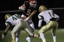 New Canaan defeated Notre Dame West Haven 51-27 in a CIAC Class L semifinal game in New Canaan on Dec. 7, 2015.